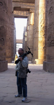 Stonie from Orlando, Florida, does some early morning photography at the Hypostyle Hall, Karnak, Luxor